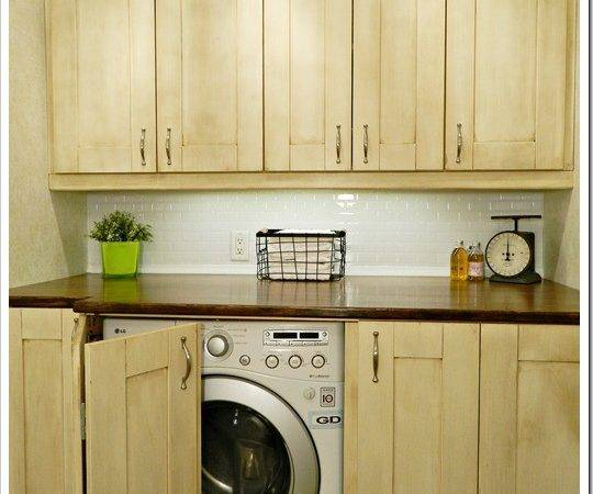 Laundry Room Light Wood Cabinets Hidden Washer
