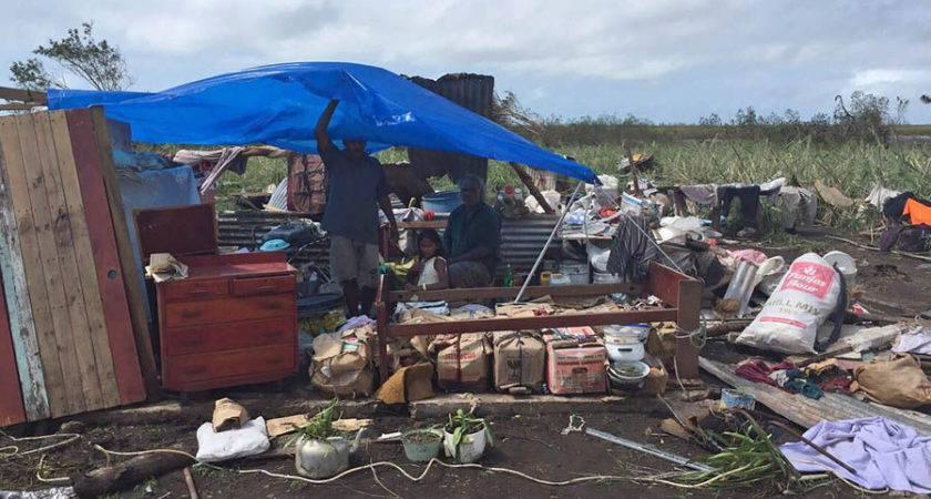 Residents Taking Shelter Under Plastic Sheet Among